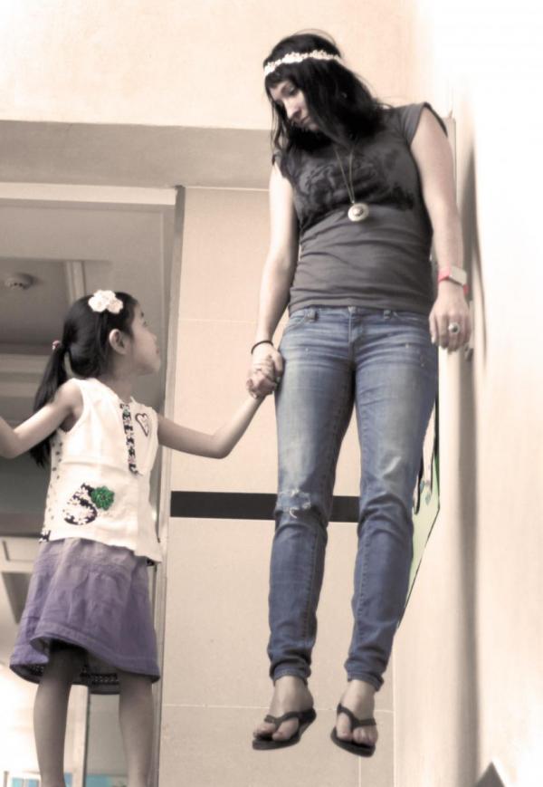 Teacher Levitating with Student