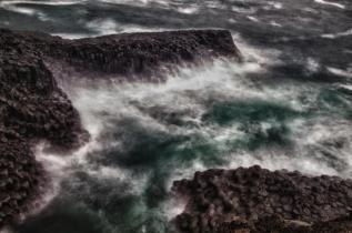 Waves Crashing on Volcanic Rocks